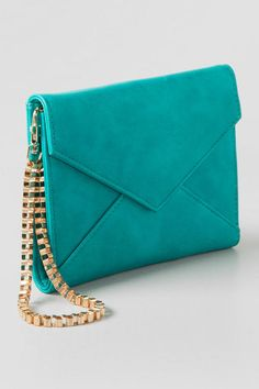 Violet Ray Clutch Wallet. Add some color to your party ware with this clutch!