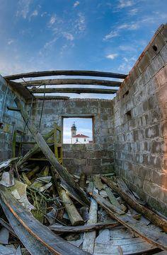 A look through the window of an old bunker at Beavertail Lighthouse on Conanicus Island, RI. by Eric Full 02/22/2014