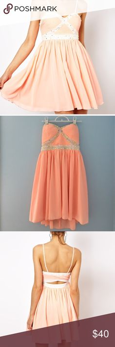 (Asos) Ginger Fizz Dress Bright peach. Never worn . Still has tags. Gorgeous cut out in back. Sequence all intact . straps are missing . They were detachable . Dress works better strapless .Uk size 10, so US  size 8. Fits more like a 6. ASOS Dresses Strapless