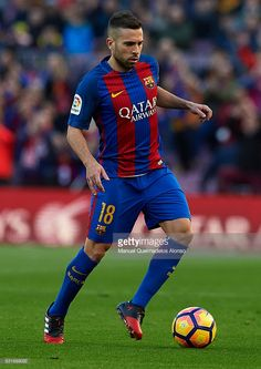 Jordi Alba of Barcelona runs with the ball during the La Liga match between FC Barcelona and UD Las Palmas at Camp Nou Stadium on January 14, 2017 in Barcelona, Spain.
