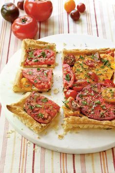 This updated tomato pie is served pizza-style on a puff pastry with a combination of feta and mozzarella cheese. An assortment of herbs along with colorful fresh tomatoes gives this tomato tart its wonderful flavor. Puff Pastry Recipes, Tart Recipes, Appetizer Recipes, Snacks Recipes, Veggie Recipes, Tomato Tart Recipe, Tomato Pie, Buttery Garlic Shrimp, Light Appetizers