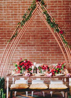 love the copper + bright red details in this pretty tablescape!