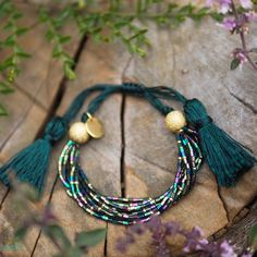 Inspired by dark green woodland hues, Forest is a handmade multi-strand bracelet made with fine glass beads, 22k gold plated beads and an adjustable sliding knot.