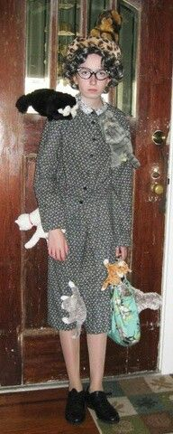 The creepy cat lady.  Thrift store dress with sewn on cats and tie up shoes.  Add some support hose, a gray wig and some cat eye glasses from the dollar store. Don't forget your purse!