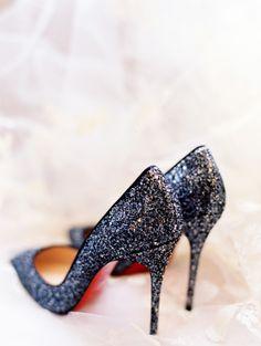 Black glittery Louboutins