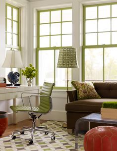 Love the chartreuse green painted window trim in this home office den. http://cococozy.com