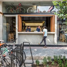 DCPP arquitectos has completed the interior design of a cycling club in mexico city. centrally located in the colonia juárez neighborhood, 'distrito fijo' is an organization that occupies a plot measuring just 85 square meters (915 square feet). as well as serving as a workshop and bike store, the scheme now also acts as a café that sells drinks and snacks throughout the day. these three pr..