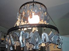 Light fixture with cookie cutters.  I'd use something less holiday oriented to keep it neutral.  Hammers and High Heels: Must See Home Decor OVERLOAD! Bachman's Idea House 2010