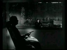 Lillian Gish waiting with a gun for  Robert Mitchum  ... dark tension in cult masterpiece Night of the Hunter 1955