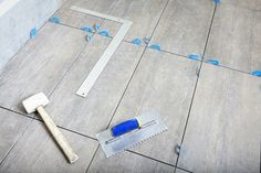 How to grout tiles and how much it costs. Find the answers to common questions around grouting tiles in our comprehensive guide. Learn the process and find a rated tiler to help you with the job. Floor Tile Grout, Grouting Tile, Tiling, Floor Design, House Design, Gallon Of Paint, Diy Flooring, Flooring Ideas, Bob Vila