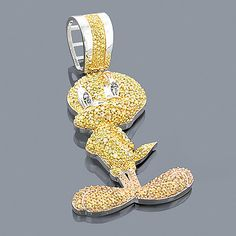This 10K Gold Tweety Bird Diamond Pendant from our fancy color diamond jewelry collection showcases 4.11 ctw of fancy yellow and blue diamonds, each masterfully set in a lustrous gold frame. Featuring a 3-d look and a highly polished gold finish, this diamond Tweety Bird pendant is fully customizable and is available in 10K white, yellow and rose gold.
