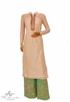 Elegant cream suit accentuated with cut-dana work at neck line