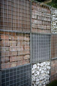 Filled Gabion wall in Hackney East London #gabionwall #gardenscreen #gardendesigneastlondon