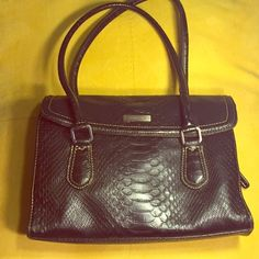 Liz Claiborne faux crocodile handbag Textured to look like crocodile. Two handles for easy carrying. Back open pocket. Snap closure. Divided inside for three compartments with pockets in each. Liz Claiborne Bags