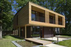 Passivhaus Villa im Park Spreti Neuenhagen bei Berlin : Moderner Balkon, Veranda & Terrasse von ArchitekturWerkstatt Vallentin GmbH