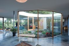 In an Oregon home, a central courtyard filled with native plants brings the outdoors in.  Photo by: Iwan Baan