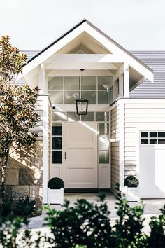 Home Renovation Exterior Hamptons style entrance of luxury home in Sydney after a full renovation Die Hamptons, Hamptons Style Homes, Hamptons Beach Houses, Home Renovation, Home Remodeling, Basement Renovations, Bathroom Renovations, Exterior Design, Interior And Exterior