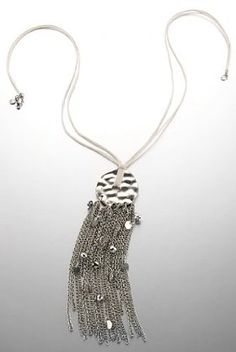 Add a bit of tassel to your outfit with this Limited Collection hammered disc & tassel sonar necklace.