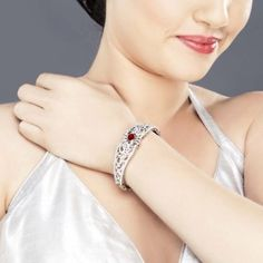 Featuring this Zircon embossed bracelet, with brilliant red center stone in our wide range of Bracelets. Grab yourself one. Now!