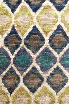 Dash & Albert | Prism Hand Knotted Jute Rug | Pretty as a peacock! This eco-friendly jute area rug, colored with vegetable dyes, features a repeating pattern of irregular diamonds in teal, navy, grey, amber, and ivory.