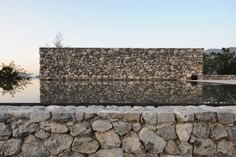 Project - The Water House - Architizer...love the stone facade...great connection to the water.