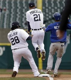 Detroit Tigers pitcher Rick Porcello jumps out of the way as first baseman Prince Fielder (28) steps on first base for the out on a grounder by Toronto Blue Jays Jose Reyes during the first inning of a baseball game in Detroit, Wednesday, April 10, 2013. (AP Photo/Paul Sancya)