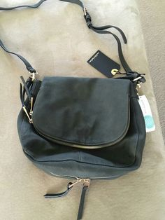 Moda Luxe Brooks Crossbody Bag - I also saw this in brown and navy. I would be happy with either of those or gray.