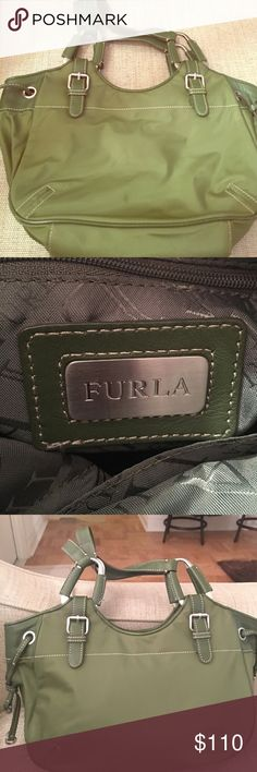 "Furla Handbag Furla Shoulder Bag - Green. Bag has some wear on the seam (pictured). Bag has drawstring details on both sides. The bag zip closes, and has an inside zipped pocket. This bag is a great ""everyday"" bag! NOT ABLE TO SHIP UNTIL THE 18th Furla Bags Shoulder Bags"