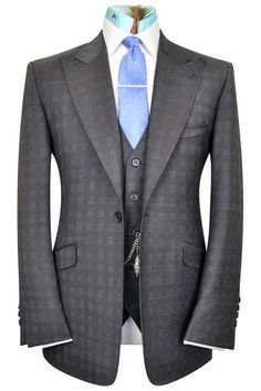 William Hunt Savile Row charcoal check three piece single breasted peak lapel suit featuring a black base lining with multi-coloured floral pattern. Boys Suits, Men's Suits, Nice Suits, King Fashion, Men's Fashion, Grey Check Suit, Made To Measure Suits, Charcoal Grey Dress, Suit Combinations