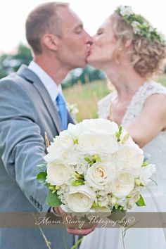 Country wedding bouquet white roses greens