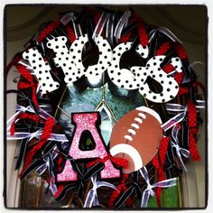 DIY football wreath - 3 rolls diff. color ribbon, wood letters, paint - pencil (use eraser end) to make polka dots, and football from local craft store.  EASY!