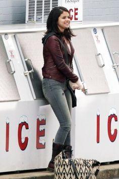 Selena Gomez wearing Ecote Woven Texture Weekender Bag and Silence + Noise Vegan Leather Fleece Moto Jacket