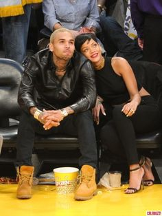 Chris Brown and Rihanna attend a basketball game between the New York Knicks and the Los Angeles Lakers at Staples Center on December 25, 2012 in Los Angeles