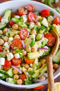 Chickpea Salad loaded with crisp cucumbers, juicy tomatoes, creamy avocado, feta cheese and chickpeas or garbanzo beans. Fresh, healthy and protein packed! #chickpeasalad #garbanzobeansalad #chickpeas #chickpeasaladrecipe #salad #saladrecipe #fetacheese #tomatosalad #avocadosalad #greeksalad #mediterraneansalad #natashaskitchen Chickpea Salad Recipes, Best Salad Recipes, Vegetarian Recipes, Cooking Recipes, Healthy Recipes, Healthy Salads, Tomato Salad Recipe, Healthy Nutrition, Recipes With Garbanzo Beans