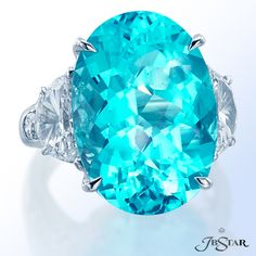 Beautiful oval paraiba ring featuring a 15.7 ct oval paraiba embraced by half moon and round diamonds. beautiful color