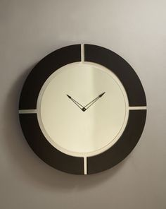 "Large Modern Wall Clock  Check out our very sexy Large Modern Wall Clock!  It has a modern black wood frame with brushed nickel accents and a mirrored face.    A very modern and contemporary wall clock for your modern apartment, home or office!    30""H x 30""W"
