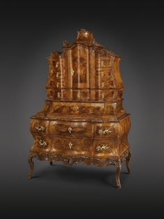 Senger Bamberg Kunsthandel – www.senger-bamberg.de Höfischer Barocksekretär Bamberg, um 1750 - Ebenist Nikolaus Bauer, Bamberg Mit ausgesuchtem Nussbaumholz furniert, Originale Patina - Höhe: 200, breite: 125, Tiefe: 65 cm Nikolaus Bauer was a court cabinet-maker in 1750 – baroque secretary - artistic/ornamental – walnut veneer – original patina  The old centre of Bamberg is a UNESCO World Heritage site  Come and see for yourself at the Bamberg Art and Antiques Fair 2016…