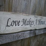 """This charming pine wood sign with the phrase Love Makes A House A Home is in a drift wood rustic design and makes a beautiful unique gift. Comes with wire hanger. Dimensions: 25"""" x3.75"""" x 1/2"""" approx  Custom made wedding and special occa..."""