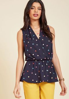 When the dress code of your workplace is anything but business as usual, this navy blue top will help you fit right in - and stand out, too! Boasting a colorful heart print and a gathered waistline that creates a peplum effect, this sprightly garment adds an element of excitement to your profesh appeal!
