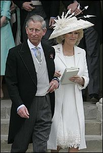 Camilla (in civil ceremony outfit) - oyster silk basket-weave coat with herringbone stitch embroidery and a chiffon dress with appliqué detail, designed by Robinson Valentine.  Philip Treacy designed her hat, which was natural straw overlaid with ivory French lace and trimmed with feathers  --  undoubtedly set the standard for middle-aged women marrying for the second time. Also great MOB outfit (in a different color, of course)