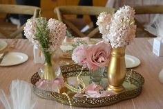 example of a vanity mirror tray used as a table centerpiece with assorted small bud vases on top, etc.