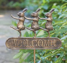 charlestongardens.com - bunny welcome sign - Welcome spring with our sign of three bunnies marching in unison. It is made of cast aluminum with a bronze finish.