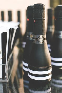 Black & white striped mini bottles of bubbly