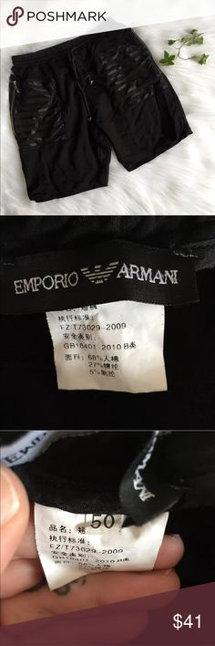 Emporio Armani Men's Shorts Zip Pockets Drawstring Emporio Armani US Men's Size Medium  EU Men's Size 50 Black stretchy shorts with drawstring waist. Zip side pockets with silver toned hardwear. Crests on the end of the drawstring in black chrome. One back pocket. Measurements 13.5 x 2 = 27 inch Waist | flat lay  14 inch Rise | the area between the waistline and the crotch 17 inch Outseam | top of pant waistband to the bottom   Please note that color may vary a small amount because of my…