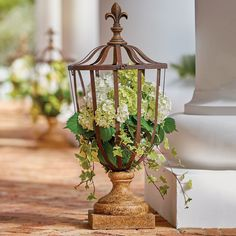 Fill this open-air planter with fleur-de-lis finial with vines, moss pots, or large, showy clusters of white, pink, or blue hydrangeas. The 3' tall urn planter has a top that easily lifts off for adding embellishments inside and its vintage-inspired brown, baked varnish adds a classic touch to any yard or garden. Use indoors or out to add color to your surroundings.