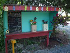 A pretty fancy roadside stand complete with chalkboard.