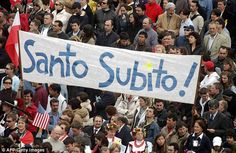 Faithful wave a banner proclaiming 'Santo subito' - Saint immediately - during Pope John Paul II's funeral in St Peter's Square on April 8, 2005