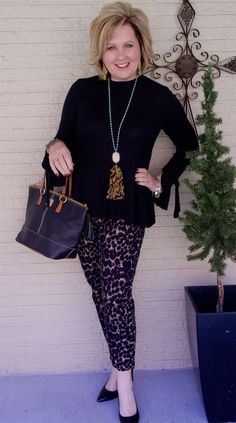 50 IS NOT OLD   GETTING IN THE CHRISTMAS SPIRIT   leopard print   bell sleeves   Fashion over 40 for the everyday woman