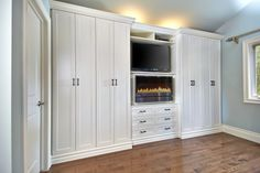 Antique White wardrobe with bronze pulls, featuring TV and electric fireplace (customer-supplied). Photo by Aaron Mason.