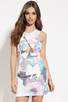A sleeveless knit dress from Paint It Red™ featuring an allover floral print with a crisscross cutout front, a bodycon fit, and an exposed back zipper. Available at Forever 21
